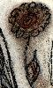 Petit dessin au fusain et à la sanguine d'une fleur.